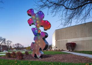 Puzzle piece light feature statues