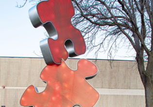 puzzle piece University Connection light feature sculpture